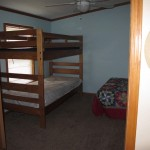 Managers House Bedroom with bed and bunk beds